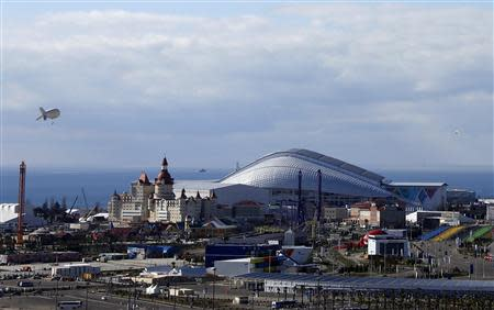 An observation balloon (top L) is seen over the Olympic Park in Sochi, February 6, 2014. Sochi will host the 2014 Winter Olympic Games from February 7 to February 23. REUTERS/Eric Gaillard