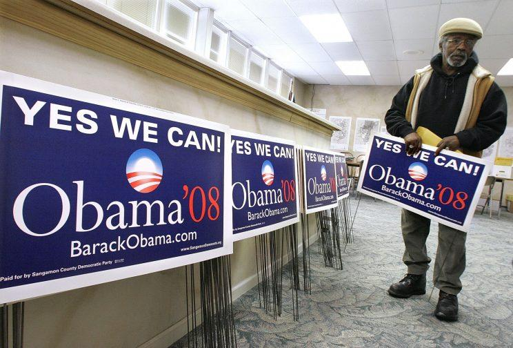 A supporter with Obama signs during the 2008 presidential campaign. (Photo: Rick Bowmer/AP)