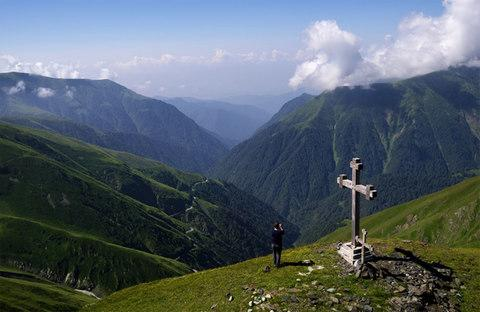 The wind-battered cross atop the Abano Pass. The 2,826-metre pass, with its free wifi hotspot, is a favored rest stop for travellers on the treacherous road from Kakheti up into the Tusheti region - Credit: Amos Chapple/RFE/RL