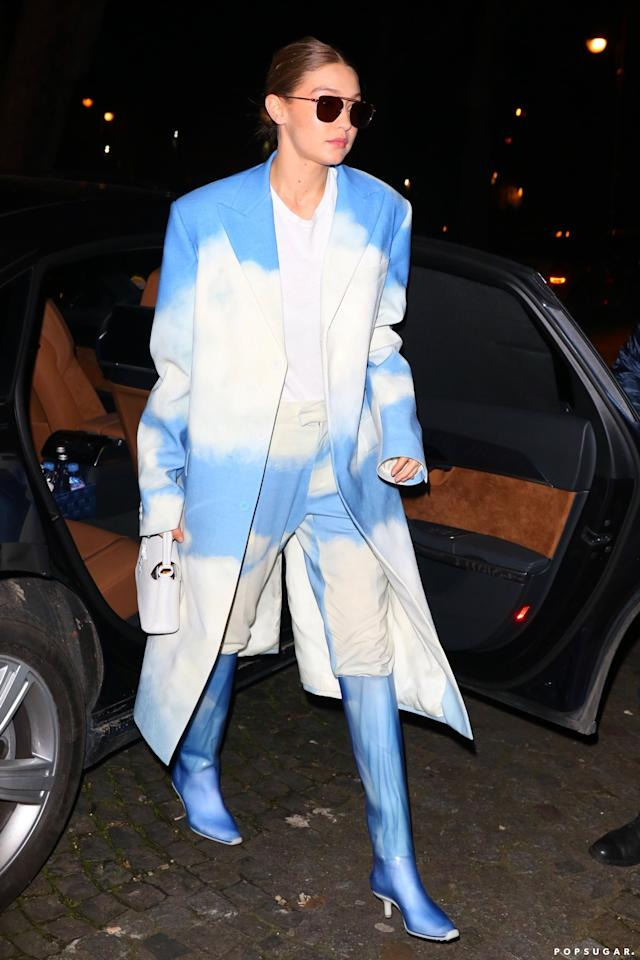 """<p>You're not dreaming; that really is Gigi Hadid wearing <a href=""""https://www.popsugar.com/fashion/gigi-hadid-cloud-louis-vuitton-suit-in-paris-47263620"""" class=""""ga-track"""" data-ga-category=""""Related"""" data-ga-label=""""https://www.popsugar.com/fashion/gigi-hadid-cloud-louis-vuitton-suit-in-paris-47263620"""" data-ga-action=""""In-Line Links"""">a cloud-print Louis Vuitton suit</a> and boots.</p>"""