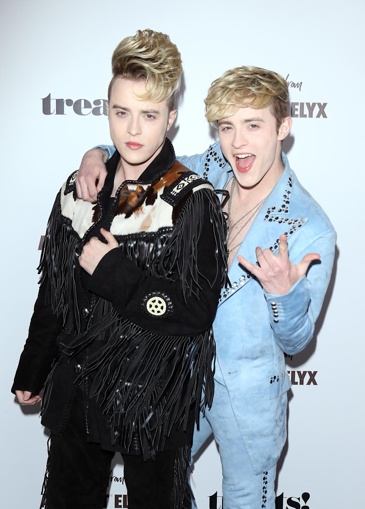 LOS ANGELES, CALIFORNIA - OCTOBER 31: John Grimes and Edward Grimes aka Jedward twins attend the Trick Or treats! Halloween Party held at No Vacancy on October 31, 2019 in Los Angeles, California. (Photo by Michael Tran/Getty Images)