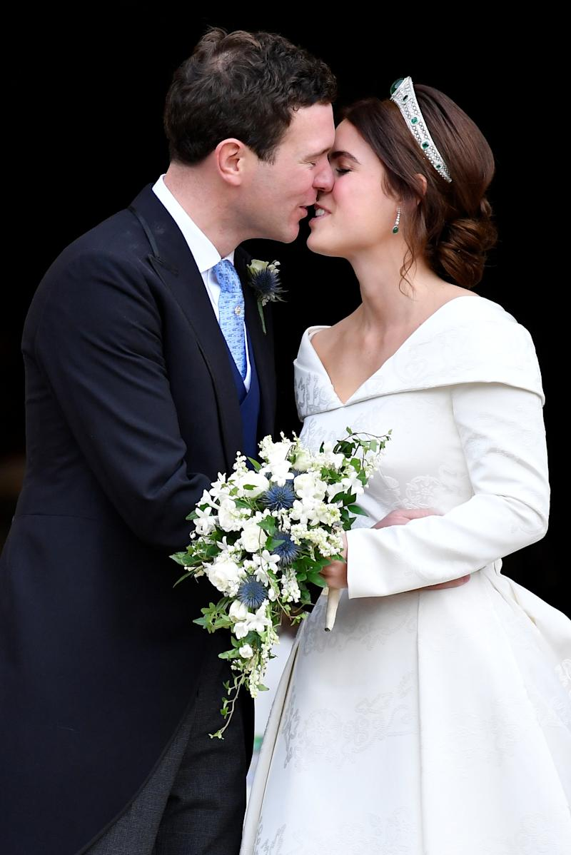 Princess Eugenie and Jack Brooksbank kiss as they leave after their wedding.