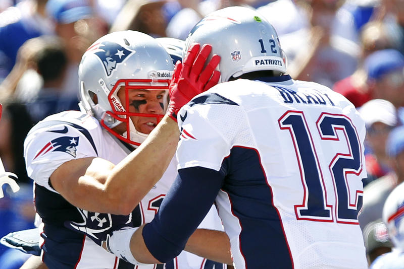 New England Patriots' Julian Edelman, left, celebrates with teammate Tom Brady, right, after catching a touchdown pass during the first half of an NFL football game against the Buffalo Bills, Sunday, Sept. 8, 2013, in Orchard Park. (AP Photo/Bill Wippert)