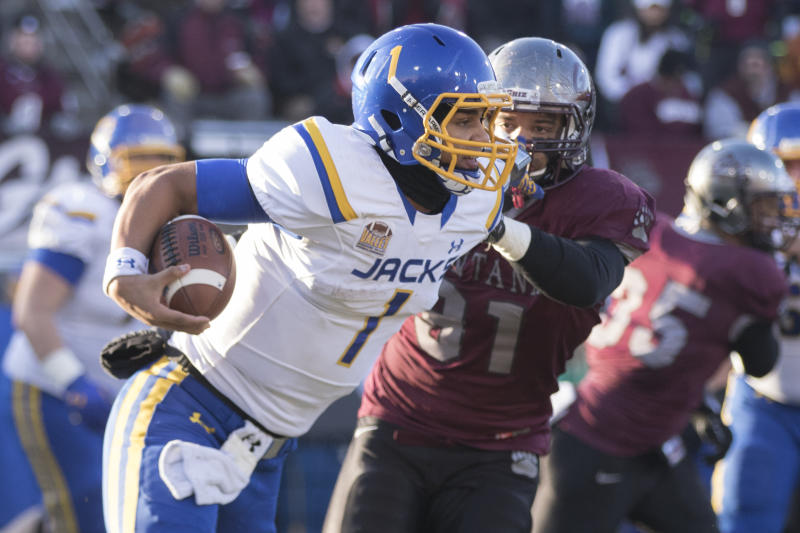 South Dakota State quarterback Taryn Christion (1) is chased down by Montana defensive end Tyrone Holmes (91) during the second half of a first-round game in the NCAA Football Championship Subdivision playoffs, Saturday, Nov. 28, 2015, in Missoula, Mont. (AP Photo/Patrick Record)
