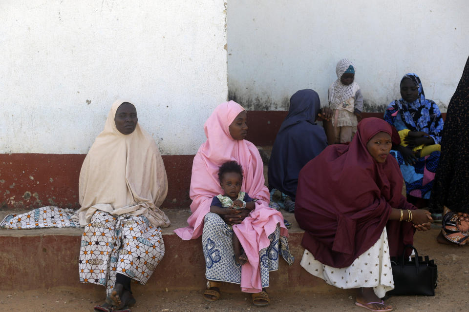 Parents of the missing Government Science secondary school students wait for news on their children in Kankara , Nigeria, Wednesday, Dec. 16, 2020. Rebels from the Boko Haram extremist group claimed responsibility Tuesday for abducting hundreds of boys from a school in Nigeria's northern Katsina State last week in one of the largest such attacks in years, raising fears of a growing wave of violence in the region. (AP Photo/Sunday Alamba)