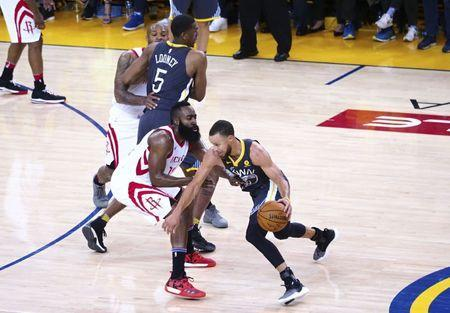 May 22, 2018; Oakland, CA, USA; Golden State Warriors guard Stephen Curry (30) drives in against Houston Rockets guard James Harden (13) during the fourth quarter in game four of the Western conference finals of the 2018 NBA Playoffs at Oracle Arena. Mandatory Credit: Kelley L Cox-USA TODAY Sports