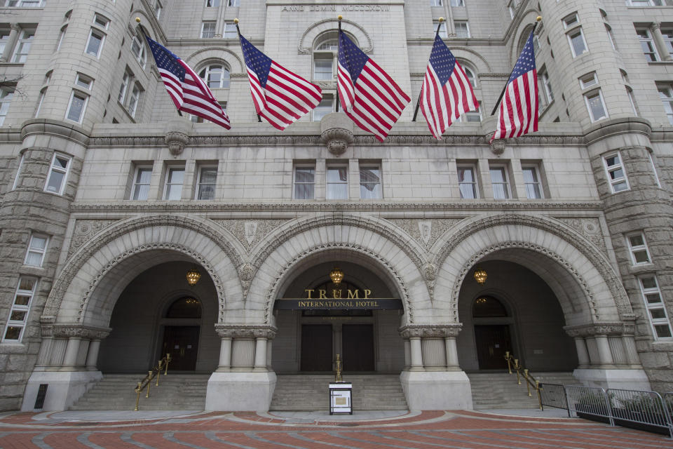 The Old Post Office Pavilion Clock Tower, which remains open during the partial government shutdown, above the Trump International Hotel, Friday, Jan. 4, 2019 ,in Washington. (AP Photo/Alex Brandon)