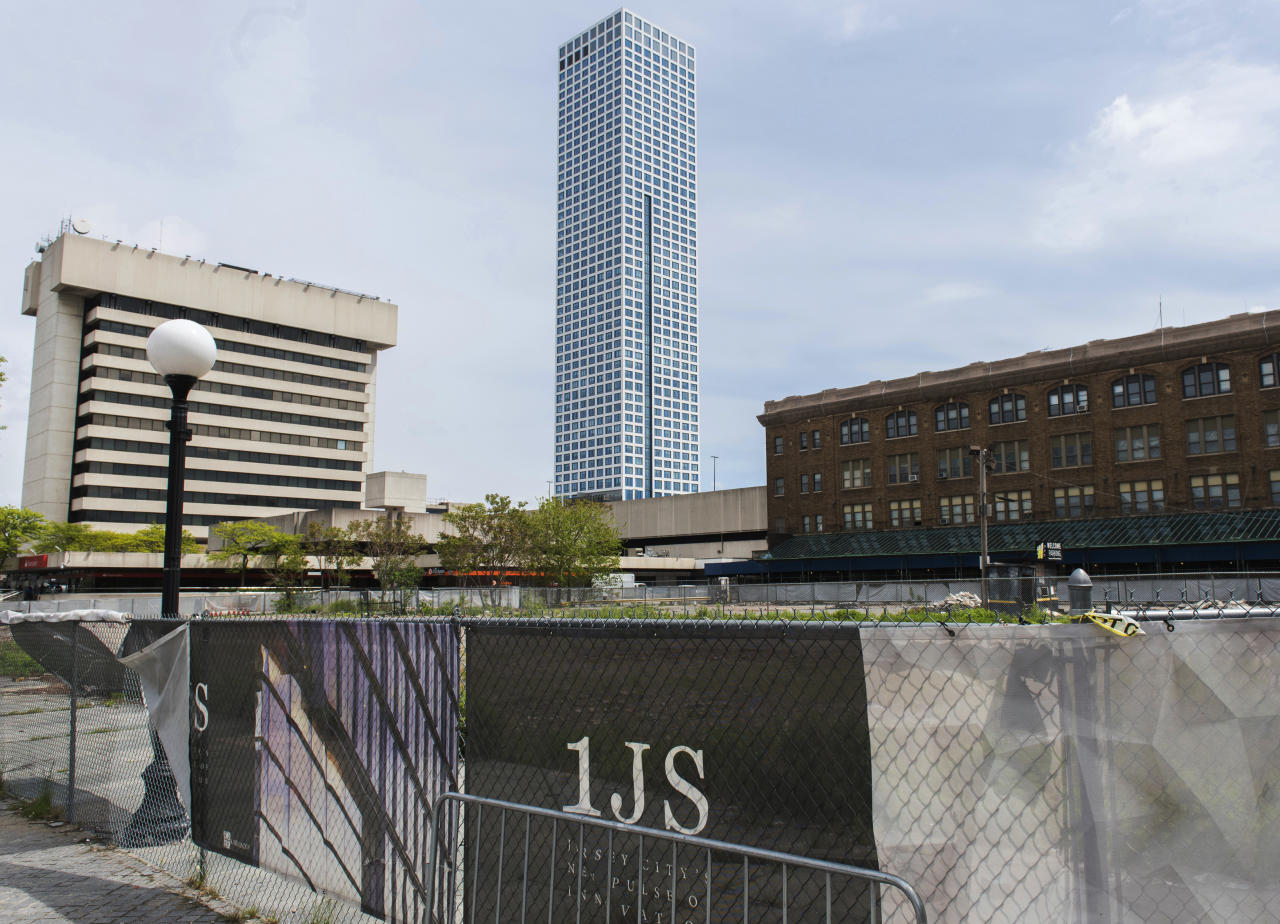 This May 8, 2017 photo shows the lot where One Journal Square, a twin-tower residential building in New Jersey championed by Jared Kushner, was to be constructed in Jersey City, N.J. Plans for the project are in danger of falling apart as his family's real estate company threatens legal action against a city that it says ended negotiations for no good reason. (Reena Rose Sibayan/The Jersey Journal via AP)