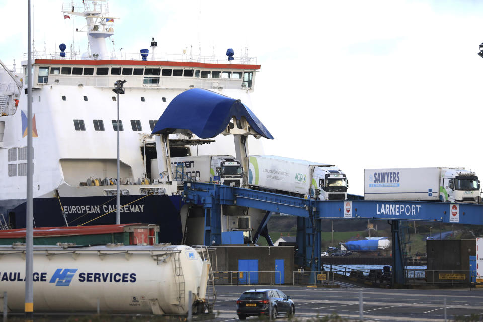 Heavy goods vehicles arrive from Scotland at the P&O ferry terminal in the port at Larne on the north coast of Northern Ireland, Friday, Jan. 1, 2021. This New Year's Day is the first day after Britain's Brexit split with the European bloc's vast single market for people, goods and services, and the split is predicted to impact the Northern Ireland border. (AP Photo/Peter Morrison)