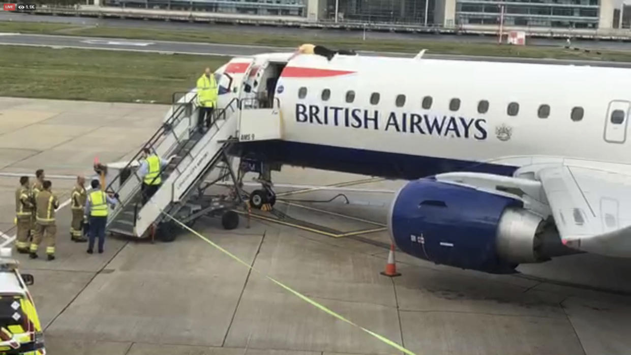 Paralympian James Brown lying on top of a British Airways plane at City Airport last week as hundreds of climate change activists demonstrated on the fourth day of world protests (AP)