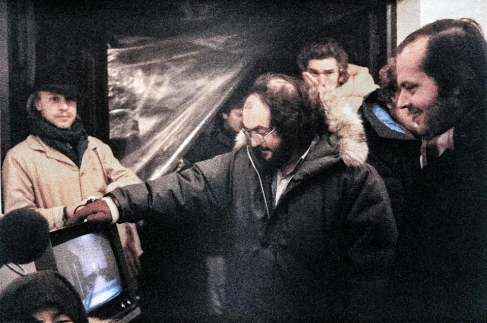 Leon Vitali (left) and Stanley Kubrick on the set of <em>The Shining</em> as Jack Nicholson (far right) looks on. (Photo: Warner Brothers/Courtesy of the Everett Collection)