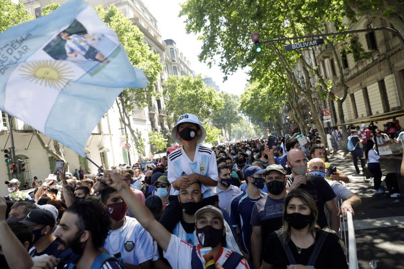 People gather to mourn the death of soccer legend Diego Armando Maradona, in Buenos Aires