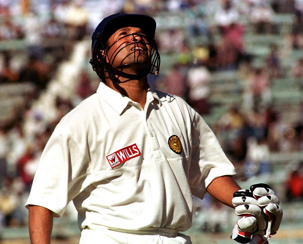 Indian skipper Sachin Tendulkar looks up after completing 200 runs during the second day of the third test match against New Zealand at the Pepsi Challange Cup in Ahmadabad 30 October 1999.  Tendulkar smashed 217 during a record-shattering blitz as India amassed 583 for seven, before declaring an hour after tea.