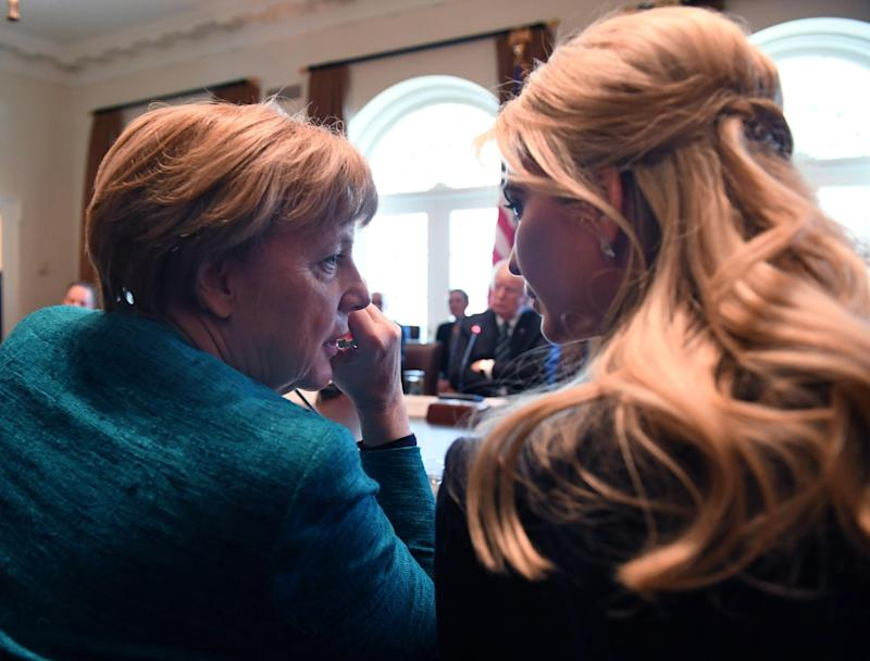 German Chancellor Angela Merkel (L) speaks with Ivanka Trump during a roundtable discussion on vocational training with United States and German business leaders in the Cabinet Room of the White House on March 17, 2017 in Washington, DC: Getty