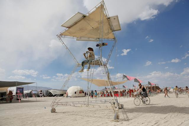 <p>A participant drives an art car as approximately 70,000 people from all over the world gathered for the annual Burning Man arts and music festival in the Black Rock Desert of Nevada, Aug. 30, 2017. (Photo: Jim Urquhart/Reuters) </p>