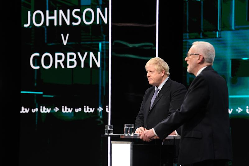 SALFORD, ENGLAND - NOVEMBER 19: (AVAILABLE FOR EDITORIAL USE UNTIL DECEMBER 19, 2019) In this handout image supplied by ITV, Prime Minister Boris Johnson and Leader of the Labour Party Jeremy Corbyn answer questions during the ITV Leaders Debate at Media Centre on November 19, 2019 in Salford, England. This evening ITV hosted the first televised head-to-head Leader's debate of this election campaign. Leader of the Labour party, Jeremy Corbyn faced Conservative party leader, Boris Johnson after the SNP and Liberal Democrats lost a court battle to be included. (Photo by Jonathan Hordle//ITV via Getty Images)