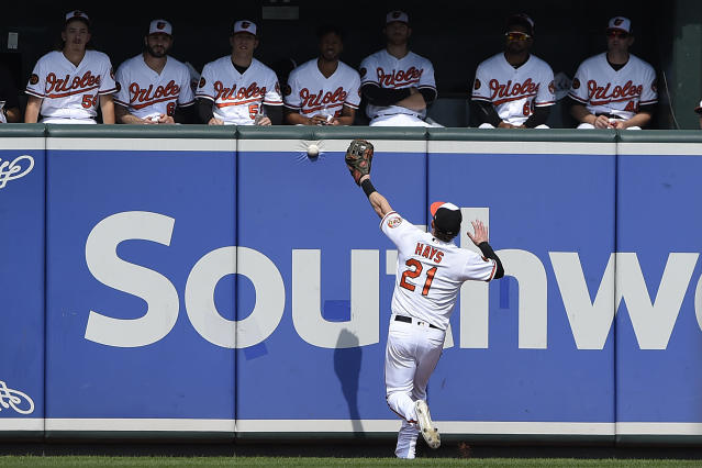 Baltimore Orioles' Austin Hays is unable to catch up with a long fly ball hit by Seattle Mariners' Shed Long in the first inning of a baseball game, Sunday, Sept. 22, 2019, in Baltimore. (AP Photo/Gail Burton)