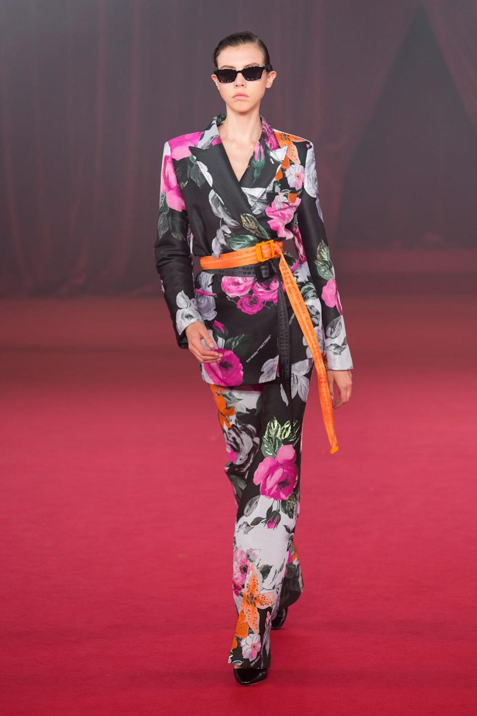 <p>Dark floral printed blazer and trousers from the SS18 Off-White collection. (Photo: ImaxTree) </p>