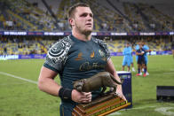 Australia's Angus Bell carries the trophy following the Rugby Championship test match between the Pumas and the Wallabies in Townsville, Australia, Saturday, Sept. 25, 2021. (AP Photo/Tertius Pickard)