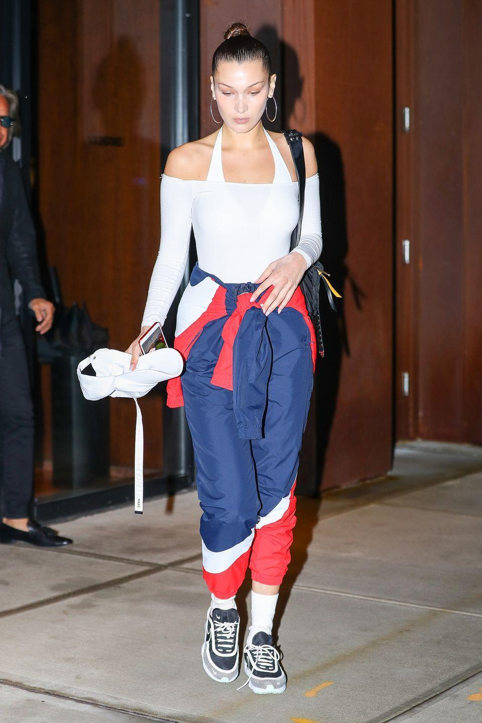 <p>In a Kith x Nike colorblock tracksuit, Nike sneakers, ATM bodysuit, and Jennifer Fisher hoop earrings while out in New York.</p>