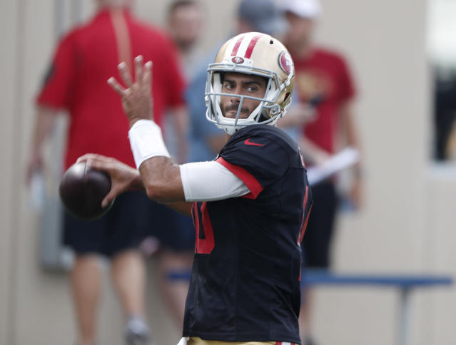 San Francisco 49ers quarterback Jimmy Garoppolo throws a pass during a combined NFL football training camp with the Denver Broncos at the Broncos' headquarters Friday, Aug. 16, 2019, in Englewood, Colo. (AP Photo/David Zalubowski)