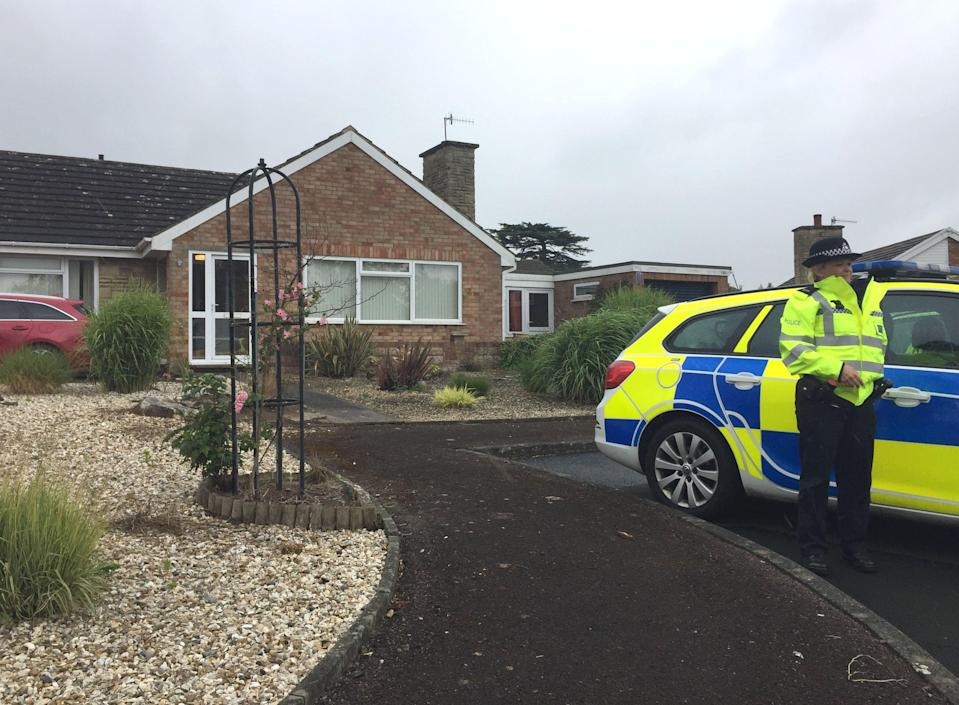 <p>Police search a home in Worchestershire</p> (PA Archive)