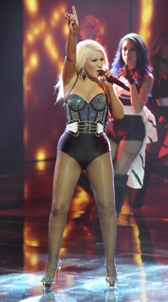 "Christina Aguilera put on quite a show Monday night when she took the stage to perform on ""<a href=""http://tv.yahoo.com/voice/show/47012"">The Voice</a>."" The coach put her famous curves on display in this bedazzled corset bodysuit, fishnet stockings and Christian Louboutin platforms, an outfit that immediately got people talking."