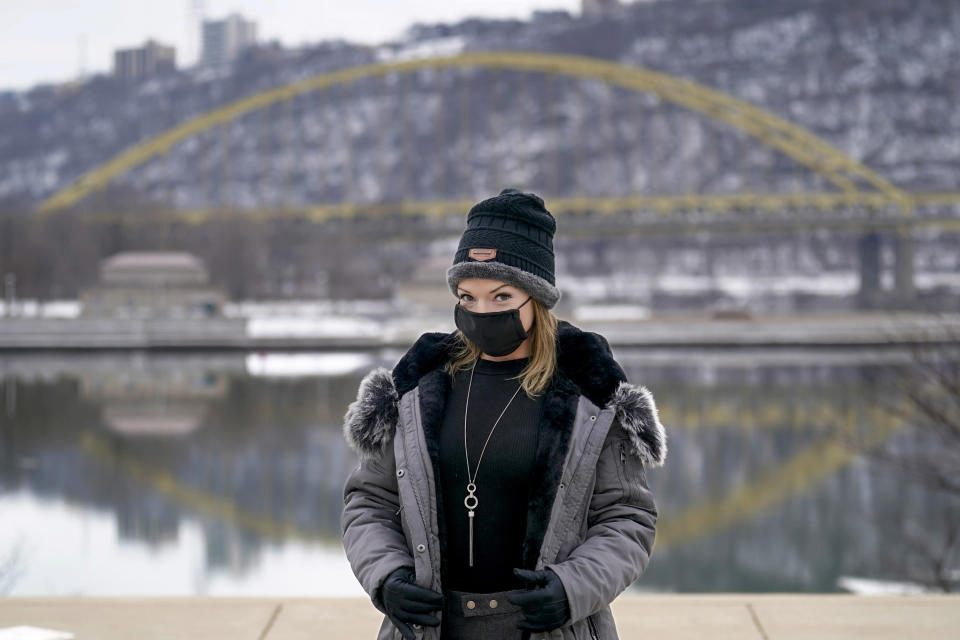"In this photo made on Monday, Feb. 8, 2021, Allissa Star poses for a photograph along the north shore of the Allegheny River in Pittsburgh. Starr worked about a week every month at a brothel in Pahrump, Nev., outside of Las Vegas. Then the pandemic led to the shuttering of Nevada's licensed bordellos, the only place where prostitution is legal in the state, and they have remained closed since March, leaving sex workers like Starr struggling to pay the bills and turning to alternatives like ""virtual"" dates. (AP Photo/Keith Srakocic)"