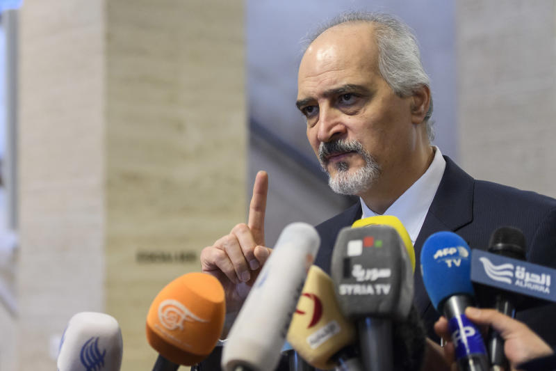Bashar al-Ja'afari, Syrian chief negotiator and Ambassador of the Permanent Representative Mission of the Syria to UN New York, briefs the media during a press conference after a round of negotiations with UN Special Envoy for Syria Staffan de Mistura at the European headquarters of the United Nations in Geneva, Switzerland, Friday, May 19, 2017. (Martial Trezzini/Keystone via AP)