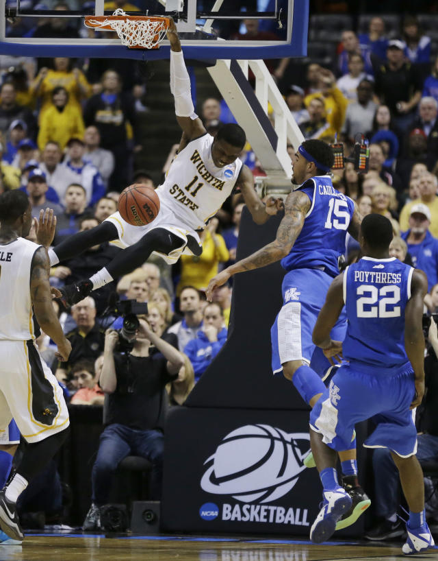 Wichita State forward Cleanthony Early (11) dunks against Kentucky during the first half of a third-round game of the NCAA college basketball tournament Sunday, March 23, 2014, in St. Louis. (AP Photo/Jeff Roberson)