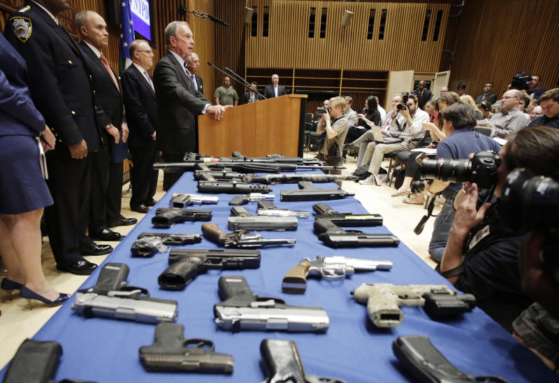New York Mayor Michael Bloomberg, center, and Police Commissioner Raymond Kelly, left, announce the arrest of 19 people and seizure of 254 guns as part of gun smuggling between the Carolinas and New York, Monday, Aug. 19, 2013 in New York. Authorities say couriers smuggled 254 guns into New York City by stashing weapons in their luggage on discount buses. (AP Photo/Mark Lennihan)