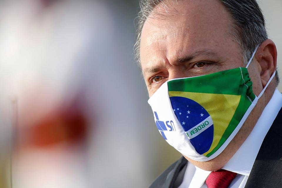 Brazil's interim Health Minister Eduardo Pazuello wears a protective face mask as he looks on before a national flag hoisting ceremony in front the Alvorada Palace, amid the coronavirus disease (COVID-19) outbreak, in Brasilia, Brazil June 9, 2020. REUTERS/Adriano Machado