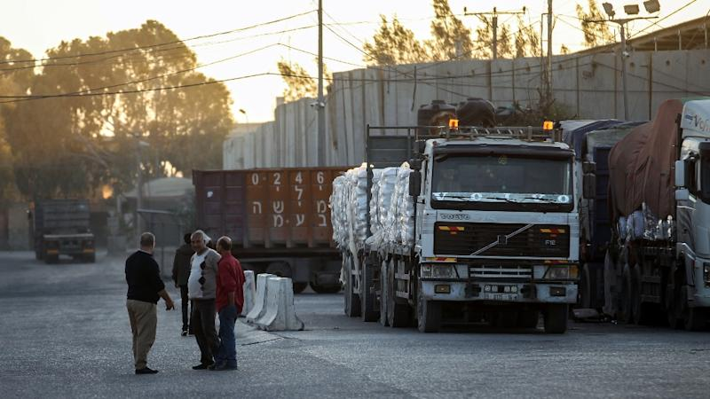 Trucks arrive at the Kerem Shalom border crossing between Israel and the Gaza Strip on November 9, 2017