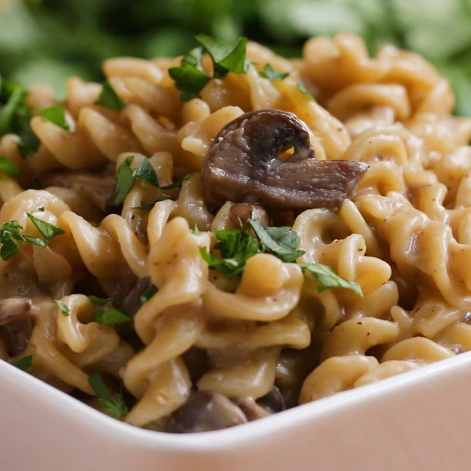 Bowl of mushroom stroganoff topped with parsley