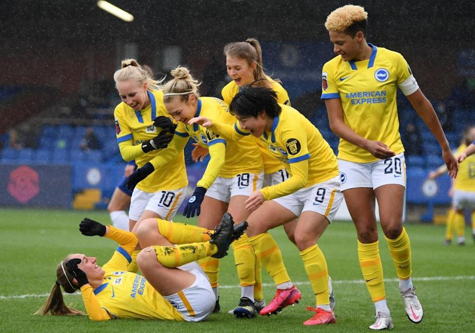 Aileen Whelan (on the ground) celebrates after a goal against Chelsea at Kingsmeadow in February.