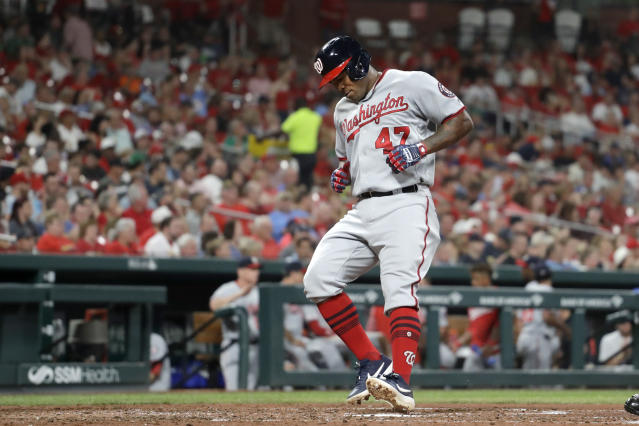 Washington Nationals' Howie Kendrick arrives home after hitting a solo home run during the fourth inning of the team's baseball game against the St. Louis Cardinals on Tuesday, Sept. 17, 2019, in St. Louis. (AP Photo/Jeff Roberson)