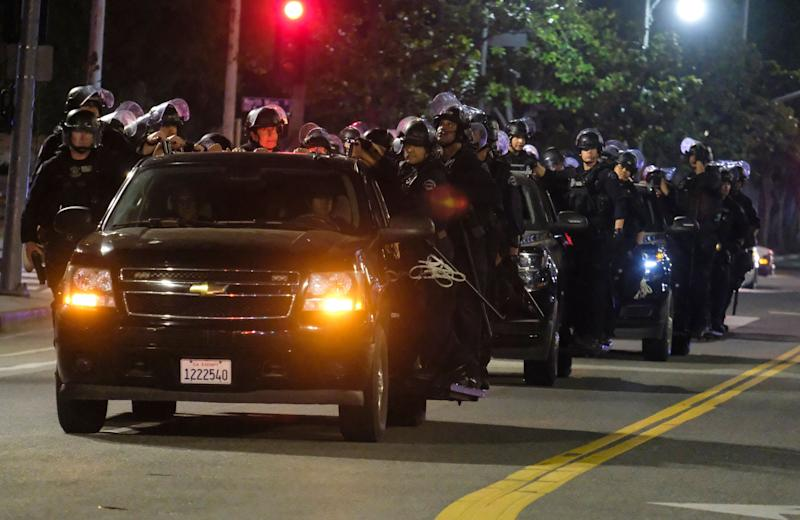 <strong>LAPD riot police stand by outside City Hall on Wednesday night.</strong> (Photo: ASSOCIATED PRESS)