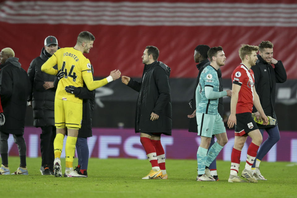 SOUTHAMPTON, ENGLAND - JANUARY 04: Fraser Forster and Danny Ings of Southampton after their sides 1-0 win during the Premier League match between Southampton and Liverpool at St Mary's Stadium on January 04, 2021 in Southampton, England. (Photo by Robin Jones/Getty Images)