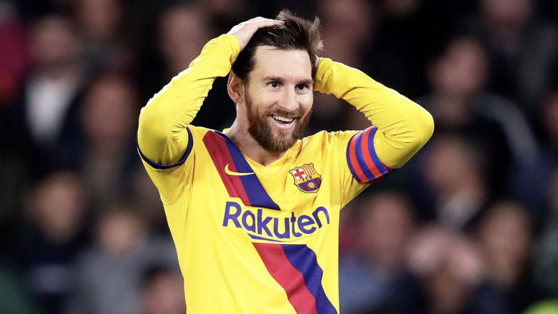 Lionel Messi with his hands on his head looking frustrated against Real Betis.