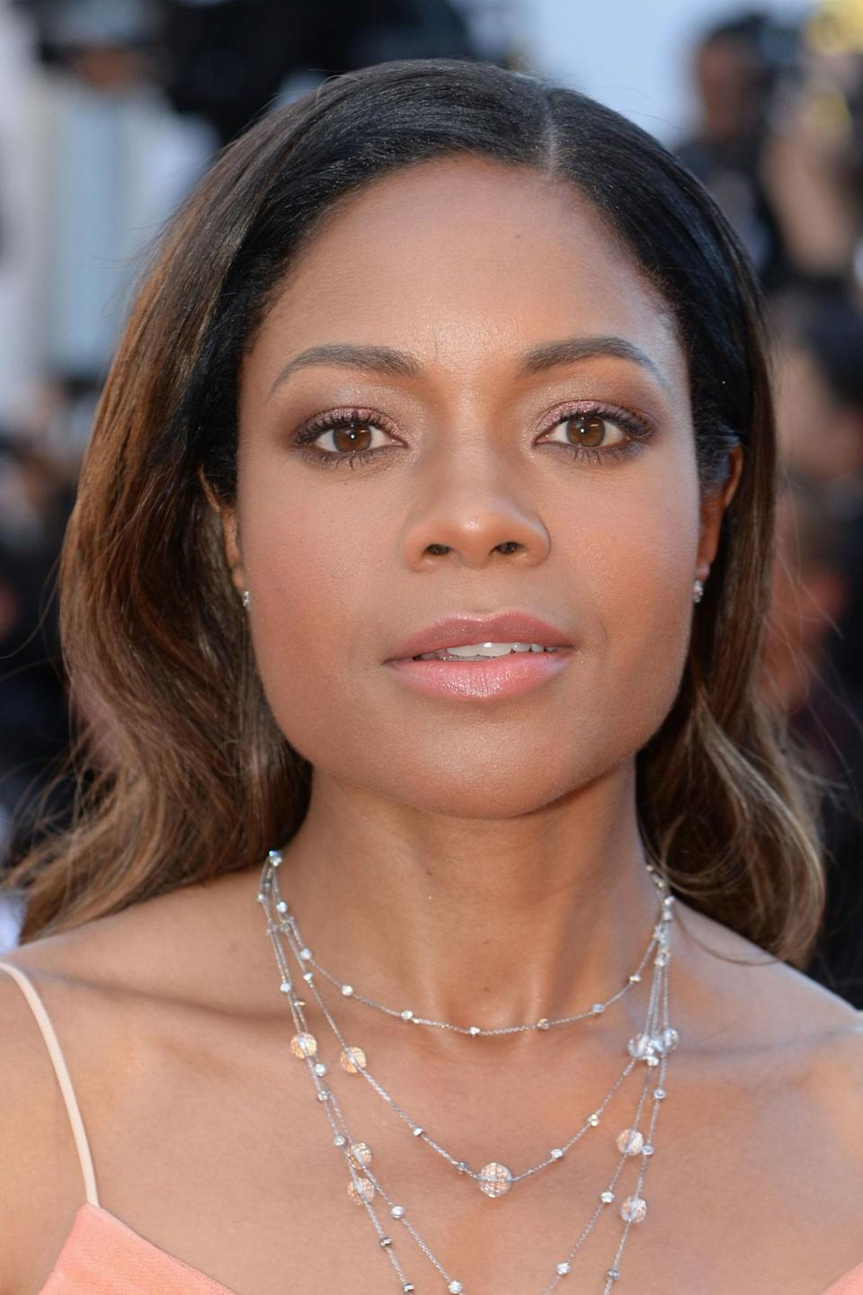 <p>Harris was pretty in pink, matching her lips to her eye make-up.</p>