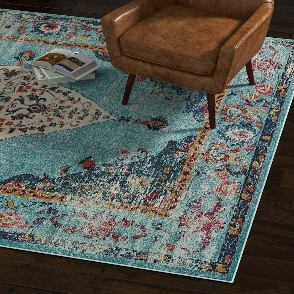 "<p>We're head over heels for this pretty <a href=""https://www.popsugar.com/buy/Rivet-Distressed-Color-Medallion-Rug-492342?p_name=Rivet%20Distressed%20Color%20Medallion%20Rug&retailer=amazon.com&pid=492342&price=60&evar1=casa%3Aus&evar9=45753841&evar98=https%3A%2F%2Fwww.popsugar.com%2Fhome%2Fphoto-gallery%2F45753841%2Fimage%2F46639062%2FRivet-Distressed-Color-Medallion-Rug&list1=shopping%2Camazon%2Chome%20decor%2Chome%20shopping&prop13=mobile&pdata=1"" rel=""nofollow"" data-shoppable-link=""1"" target=""_blank"" class=""ga-track"" data-ga-category=""Related"" data-ga-label=""https://www.amazon.com/Rivet-Distressed-Color-Medallion-Aqua/dp/B073F92XNV/ref=sr_1_11?keywords=rivet%2Bhome%2Bdecor&amp;qid=1568846586&amp;s=gateway&amp;sr=8-11&amp;th=1"" data-ga-action=""In-Line Links"">Rivet Distressed Color Medallion Rug</a> ($60-$200).</p>"
