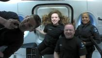 This photo provided by SpaceX shows the passengers of Inspiration4 in the Dragon capsule on their first day in space. They are, from left, Jared Isaacman, Hayley Arceneaux, Chris Sembroski and Sian Proctor. SpaceX got them into a 363-mile (585-kilometer) orbit following Wednesday night's launch from NASA's Kennedy Space Center. That's 100 miles (160 kilometers) higher than the International Space Station. (SpaceX via AP)