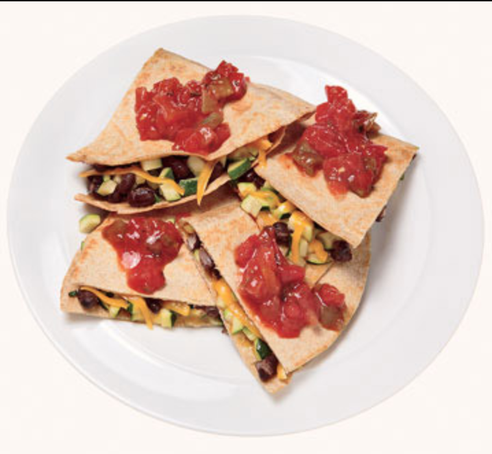 """<p>Think 500-calorie meals have to be boring? Not so fast. This easy-to-whip-up dish will remind you of your favorite Mexican restaurant, with a dose of nutrition that is: Zucchini, black beans, and salsa infuse vegetables and healthy fiber into the mix while cumin adds the spice you're craving. (If you are eating, here's <a href=""""https://www.shape.com/healthy-eating/meal-ideas/taco-bell-nutritionist-approved-healthy-orders"""" target=""""_blank"""">what nutritionists order at Taco Bell</a>!)</p> <p><strong>Serves:</strong> 1</p> <p><strong>Ingredients:</strong><br /> 1 cup chopped zucchini<br /> 1/2 cup canned black beans, rinsed and drained<br /> 2 teaspoons olive oil<br /> 1 teaspoon cumin<br /> 2 whole wheat tortillas<br /> 1/4 cup shredded cheddar cheese<br /> 2 tablespoons salsa</p> <p><strong>Directions: </strong><br /> Saute first four ingredients for 5 minutes. Place mixture on tortillas; sprinkle with cheese. Fold in half and cook in pan until cheese melts and tortilla is toasted. Top with salsa.</p>"""