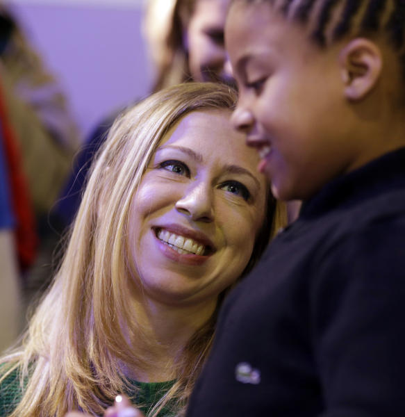 National Day of Service Honorary Chair, Chelsea Clinton, participates service project with Addison Rose, 8, of Washington, on the National Mall as part of the Inaugural event Saturday, Jan. 19, 2013 in Washington,. The two made cards for the Sunshine Mail Foundation that sends the cards along with care packages to the ill and disadvantaged people. (AP Photo/Steve Helber)