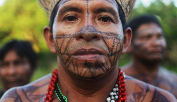 Indigenous men look on during a ceremony honoring the Xingu River before the start of the Xingu  23 event that gathers resisters of the Belo Monte dam project in the Amazon basin on June 13, 2012 in Santo Antonio, near Altamira, Brazil. Santo Antonio is adjacent to where the Belo Monte dam complex is under construction and the entire community will be expropriated for the construction. Around 60 families originally lived in Santo Antonio but now only about ten families remain. Xingu  23 is an event running parallel to the United Nations Rio   20 event and marks 23 years since the first meeting of indigenous peoples opposed to the dam in 1989. Mario Tama/Getty Images