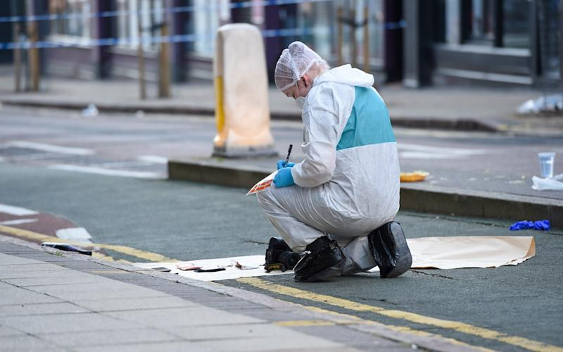 A forensic officer collecting evidence on Hurst Street, Birmingham - SnapperSK