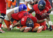 Arizona quarterback Anu Solomon (12) falls backwards after being hit by Boise State defensive end Beau Martin (53) during the first half of the Fiesta Bowl NCAA college football game, Wednesday, Dec. 31, 2014, in Glendale, Ariz. (AP Photo/Ross D. Franklin)