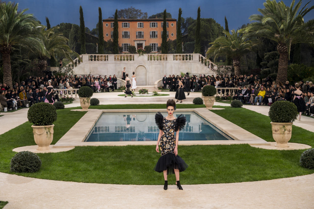 <p>Lagerfeld referenced the 18th century with his spring/summer 2019 haute couture collection in January 2019. Set in the imagined 'Villa Chanel', models walked around a pond among palm trees. <em>[Photo: Getty]</em> </p>