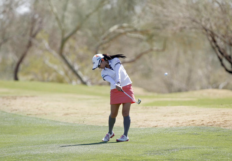 Ai Miyazato, of Japan, hits her approach shot off the third fairway during the first round of the Founders Cup golf tournament on Thursday, March 14, 2013, in Scottsdale, Ariz.(AP Photo/Paul Connors)