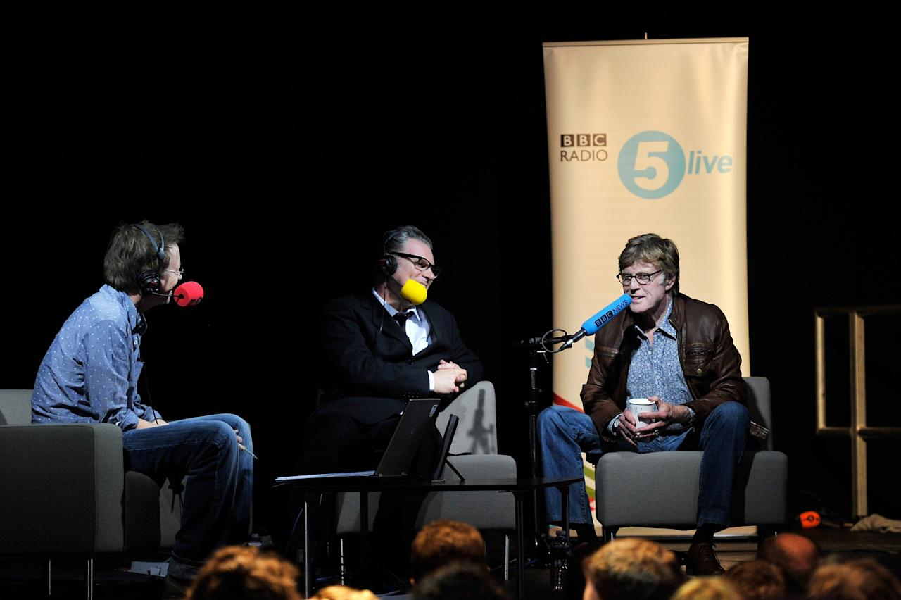 LONDON, ENGLAND - APRIL 27:  Founder and President of Sundance Institute Robert Redford (R)  is interviewed by Simon Mayo  (L) and Mark Kermode (C) at BBC Radio 5 Live at  on April 27, 2012 in London, England.  (Photo by Gareth Cattermole/Getty Images for Sundance/AEG Europe)